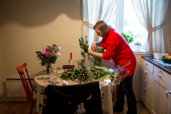 Kala #16. Linda sorting through the farewell flower gifts